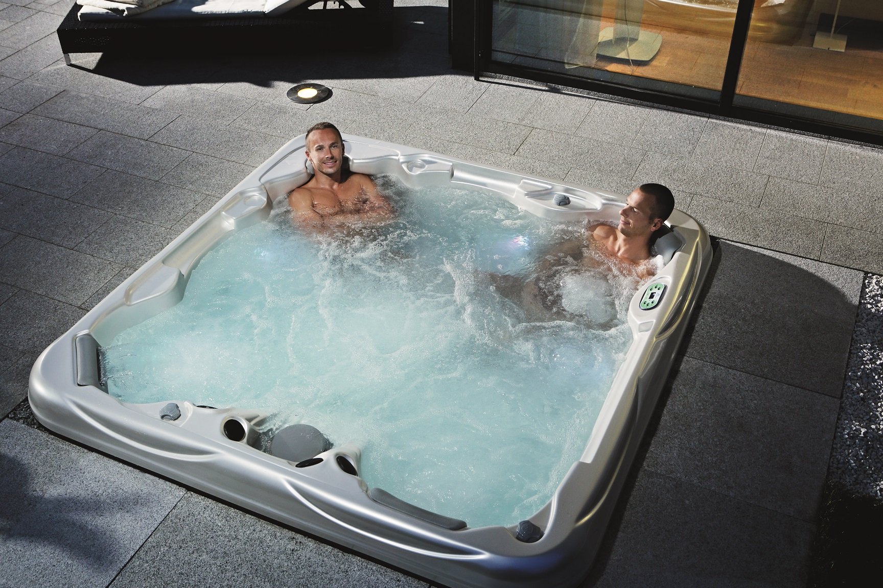 Portable Spa Installed in to a Concrete Pit.